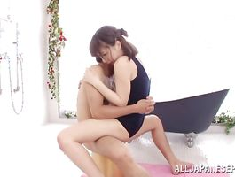 Awesome playgirl Hitomi Fujiwara rides a knob reverse cowgirl style