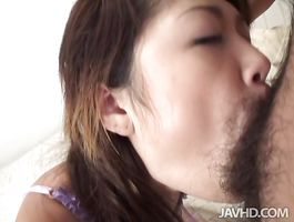 Tasty doll Warin Umino with huge tits eagerly sucks on her stud's overweight cockhead