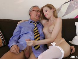 Luxurious blonde Angel Hott's butt is plugged while she chokes on hard cock